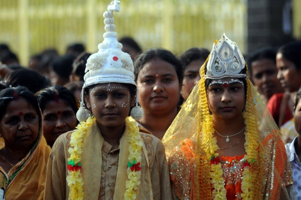 Agartala, India. 7th March 2012 -- Women dressed as bride and groom during a rally. -- Indian women take out a rally organised by Social welfare department to mark International Women's Day on the eve at India's northeastern capital of Agartala. International Women's Day is celebrated across the world on 8th March 2012.